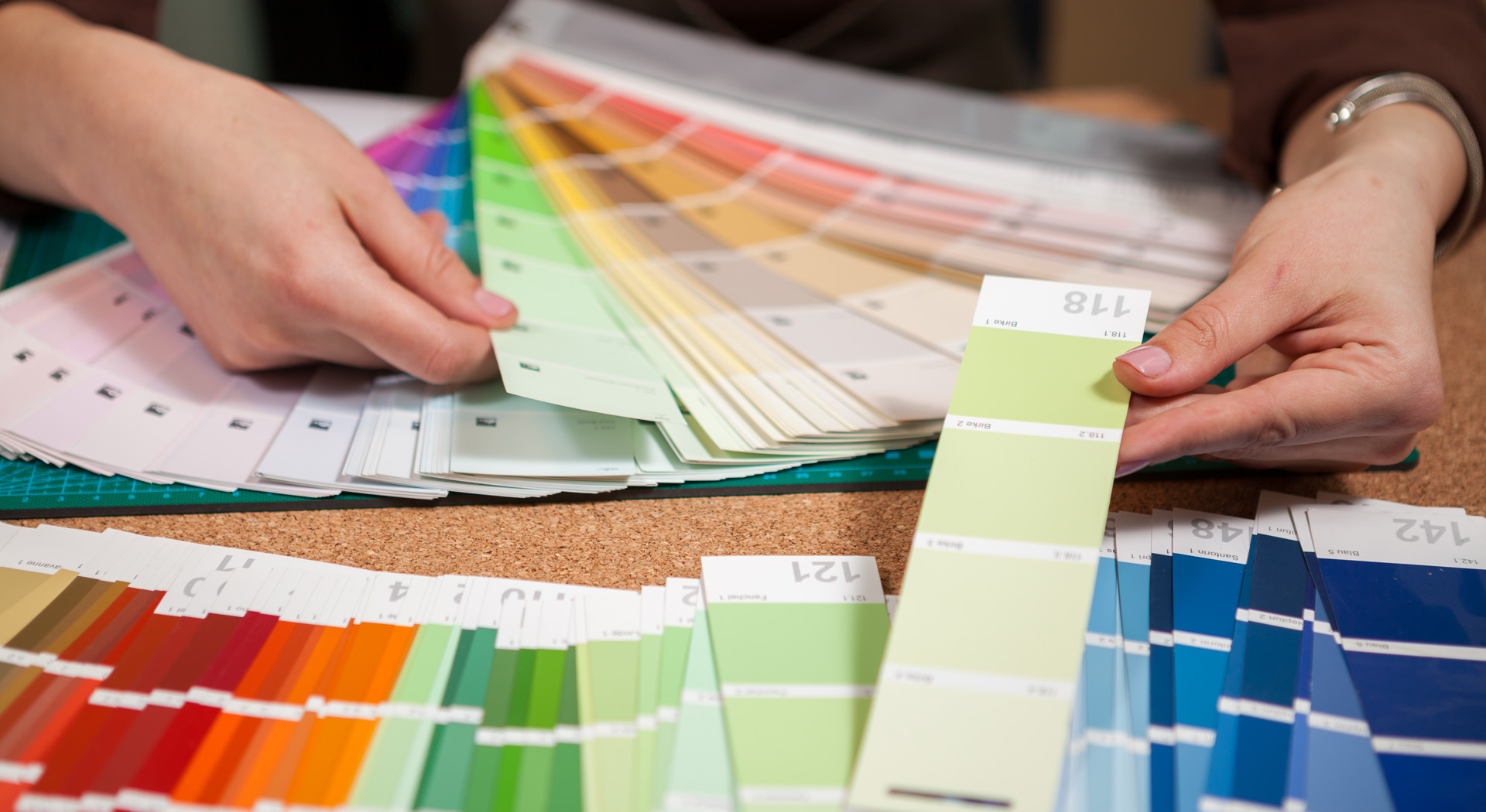 Close up image of color cards on architect desk